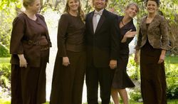 """** FILE ** In this undated file photo provided by TLC, Kody Brown, center, poses with his wives, from left, Janelle, Christine, Meri and Robyn in a promotional photo for TLC's reality TV show, """"Sister Wives."""" In new federal court papers, Kody Brown and his wives say they've lost jobs, were forced to move out of state and suffered """"reputational"""" harm by a police investigation last year. (AP Photo/TLC, Bryant Livingston, File)"""
