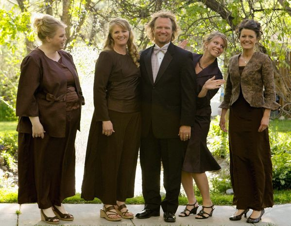 "** FILE ** In this undated file photo provided by TLC, Kody Brown, center, poses with his wives, from left, Janelle, Christine, Meri and Robyn in a promotional photo for TLC's reality TV show, ""Sister Wives."" In new federal court papers, Kody Brown and his wives say they've lost jobs, were forced to move out of state and suffered ""reputational"" harm by a police investigation last year. (AP Photo/TLC, Bryant Livingston, File)"