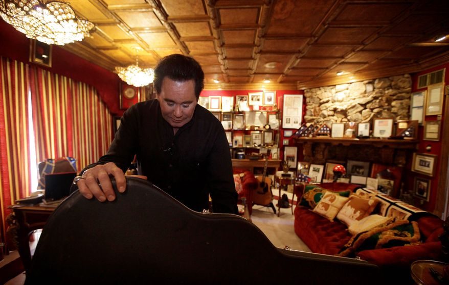 Singer Wayne Newton shows some of the show business memorabilia  in his Las Vegas home. He hopes to start public tours by February. He and his  family will move into a smaller house on the property.