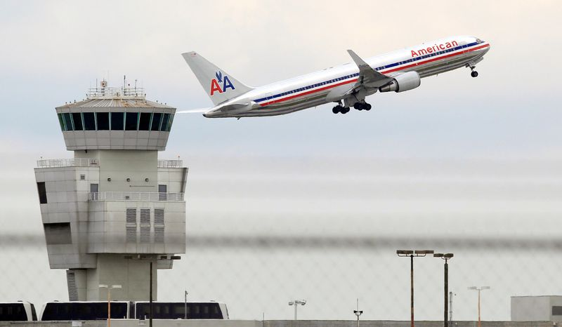 Higher fares weren't enough to prevent another loss at American Airlines parent AMR Corp., which lost $162 million in the third quarter this year. Major airlines this week joined in the first widespread airfare increase since early August. (Associated Press)