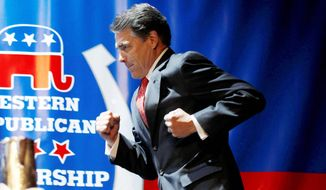 Texas Gov. Rick Perry runs to deliver a keynote address during the Western Republican Leadership Conference in Las Vegas on Wednesday. (Associated Press)