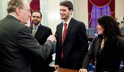 Sen. John D. Rockefeller IV, West Virginia Democrat (left), talks with witnesses Dr. Jeffrey Kutcher, an assistant professor at the University of Michigan Department of Neurology; Steven Threet (center), a former Arizona State quarterback; and Alexis Ball, a senior at the University of New Mexico, before a hearing Wednesday on sports concussions and the marketing of protective equipment. (T.J. Kirkpatrick/The Washington Times)
