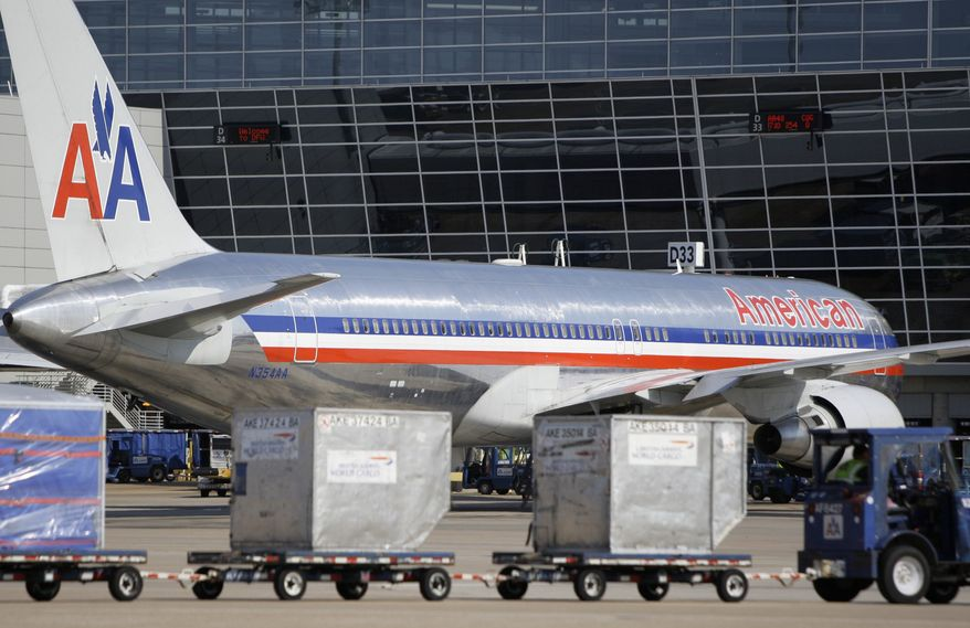 ** FILE ** This June 29, 2011, file photo, shows an American Airlines aircraft at Terminal D at Dallas-Fort Worth International Airport, in Grapevine, Texas. (AP Photo/Tony Gutierrez, File)