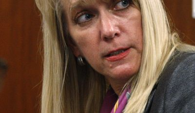 Victoria Tindall, an Oklahoma assistant attorney general, answers a question following a hearing on a state abortion law on Tuesday, Oct. 18, 2011, in Oklahoma City. (AP Photo/Sue Ogrocki)