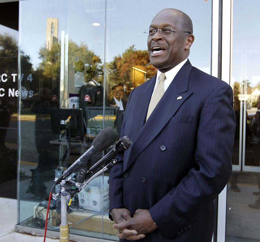 Republican presidential candidate, businessman Herman Cain, speaks with the media after an interview on NBC's Meet the Press at their studio in Washington on Sunday, Oct. 16, 2011. (AP Photo/Jose Luis Magana)