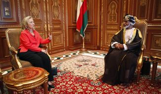 U.S. Secretary of State Hillary Rodham Clinton talks with Sultan Qaboos bin Sa'id at the sultan's palace in Muscat, Oman, on Wednesday, Oct. 19, 2011. Mrs. Clinton personally thanked the sultan for his help in securing the release of three American hikers detained in Iran. She later arrived in Afghanistan on an unannounced visit. (AP Photo/Kevin Lamarque, Pool)