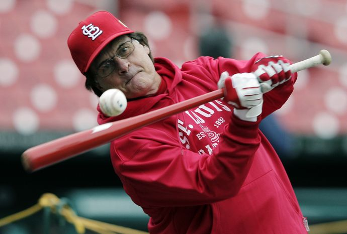 St. Louis Cardinals manager Tony La Russa hits during practice for Game 1 of the World Series against the Texas Rangers on Tuesday, Oct. 18, 2011, in St. Louis. (AP Photo/Charlie Riedel)