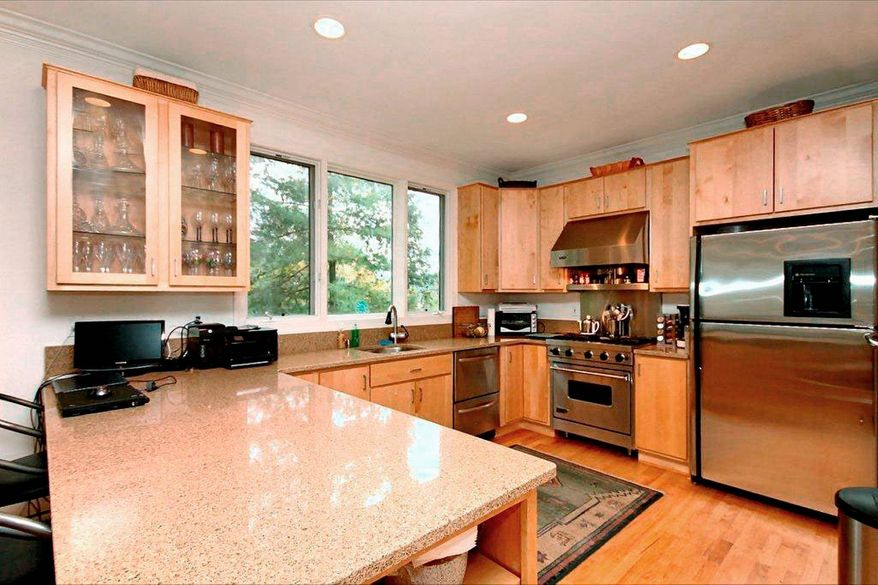 The kitchen, which recently was renovated, has granite counters and maple cabinets.