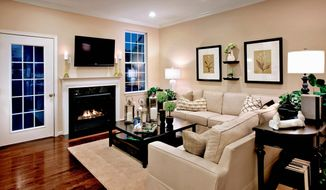 The family room in the Lindenhurst model has a fireplace. The Lindenhurst has 1,953 square feet and is priced from $325,995.