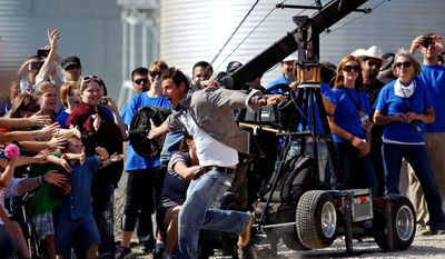 "Host Ty Pennington and the ""Extreme Makeover: Home Edition"" crew's latest project is to build seven homes in seven days in Joplin, Mo. The community was devastated by a May 22 tornado that killed 162 people. (Waterloo Courier via Associated Press)"