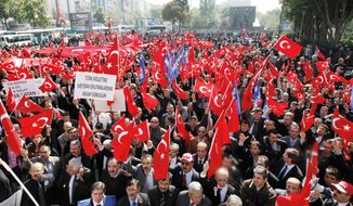 Thousands of high school students and citizens march in the streets of Ankara, the Turkish capital, on Thursday to denounce the killing of 24 soldiers by Kurdish rebels as the military pressed ahead with its air and ground offensive against the insurgents across the Iraqi border. (Associated Press)