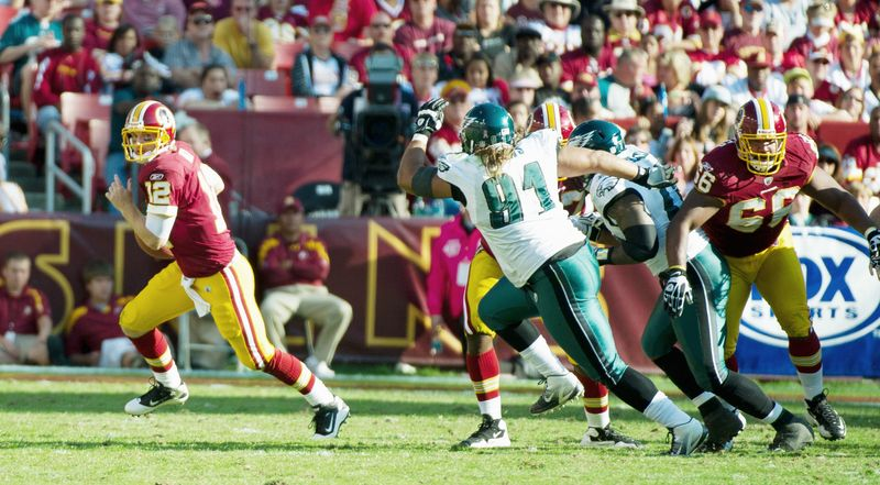 Washington Redskins quarterback John Beck scrambles for a pass against Philadelphia Eagles during the fourth quarter at FedEx Field in Landover, Md. Sunday, October 16, 2011. (Rod Lamkey Jr. / The Washington Times)