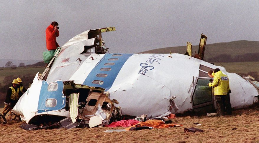 In 1988, investigators sift through Pan Am Flight 103 wreckage in Lockerbie, Scotland. Moammar Gadhafi's reported death resonated with the families who had loved ones on the airliner and who held Col. Gadhafi responsible for approving the bombing that killed 270 people.
