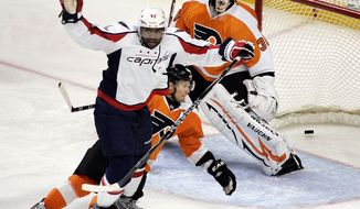** FILE ** Washington Capitals' Joel Ward reacts after scoring a goal against the Philadelphia Flyers on Thursday, Oct. 20, 2011, in Philadelphia. The Capitals won 5-2. (AP Photo/Tom Mihalek)