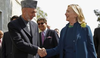 U.S. Secretary of State Hillary Rodham Clinton meets with Afghan President Hamid Karzai at the Presidential Palace in Kabul, Afghanistan, on Thursday, Oct. 20, 2011. (AP Photo/Kevin Lamarque, Pool)