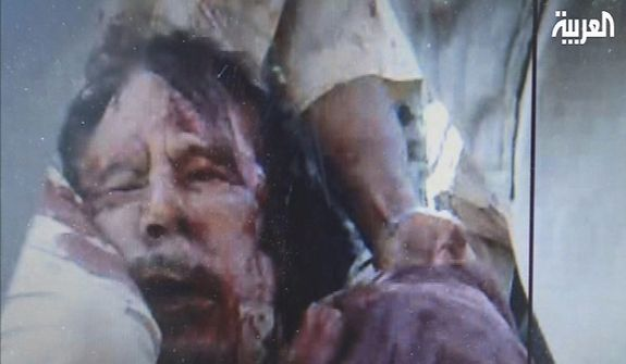 This image from video broadcast on Al-Arabiya television is said to show Moammar Gadhafi in Sirte, Libya, on Oct. 20, 2011. Libya's information minister said Moammar Gadhafi was killed when revolutionary forces overwhelmed his hometown, Sirte, the last major bastion of resistance two months after the regime fell. (Associated Press)