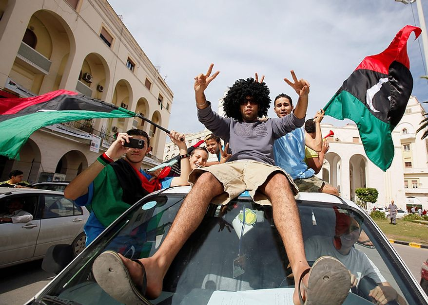 Libyans celebrate Col. Moammar Gadhafi's death in Tripoli, Libya, on Oct. 20, 2011. (Associated Press)