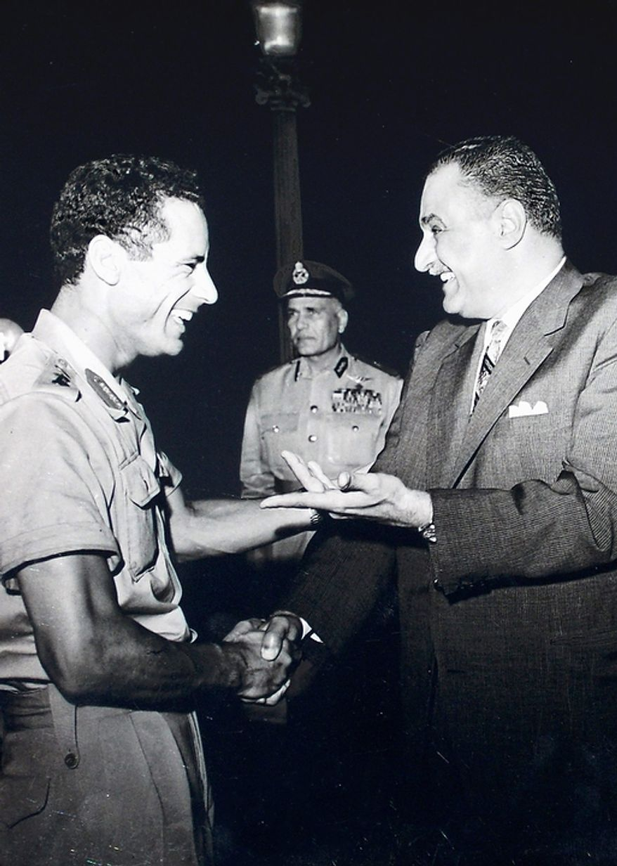 In this photo from October 1969, Col. Moammar Gadhafi (left) appears with Egypt's Prime Minister Gamal Abdel Nasser (right) during his first official visit to Egypt after a military coup in Libya. (Associated Press)
