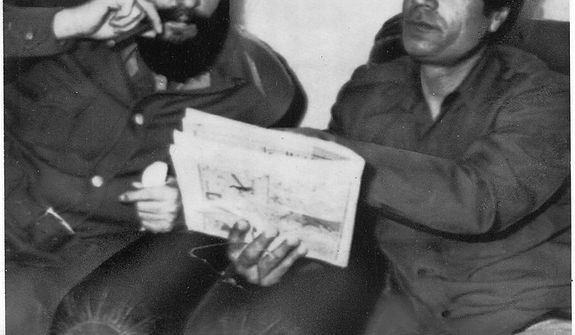 In this photo from March 8, 1977, Cuban leader Fidel Castro (left) sits with Col. Moammar Gadhafi in Tripoli. (Associated Press)