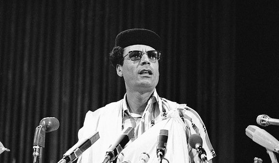 In this photo from Aug. 18, 1976, Libyan leader Col. Moammar Gadhafi speaks to the summit meeting of the nonaligned nations in Colombo, Sri Lanka. (Associated Press)