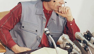 In this photo from Jan. 9, 1986, Libyan leader Col. Moammar Gadhafi listens to a question during a news conference at his Tripoli headquarters. (Associated Press)