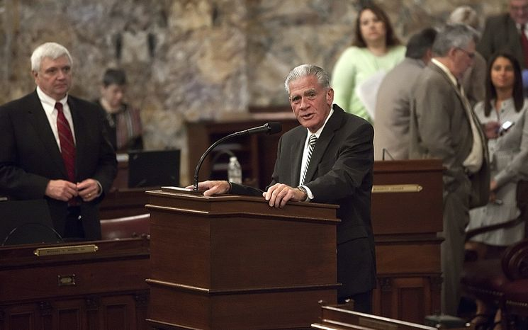 Rep. Ronald Buxton, D-Dauphin, speaks in favor of a bill aimed at giving Pennsylvania Gov. Tom Corbett the power to force Harrisburg, Pa., into a state-sanctioned plan to deal with its staggering debt, Wednesday, Oct. 19, 2011, at th