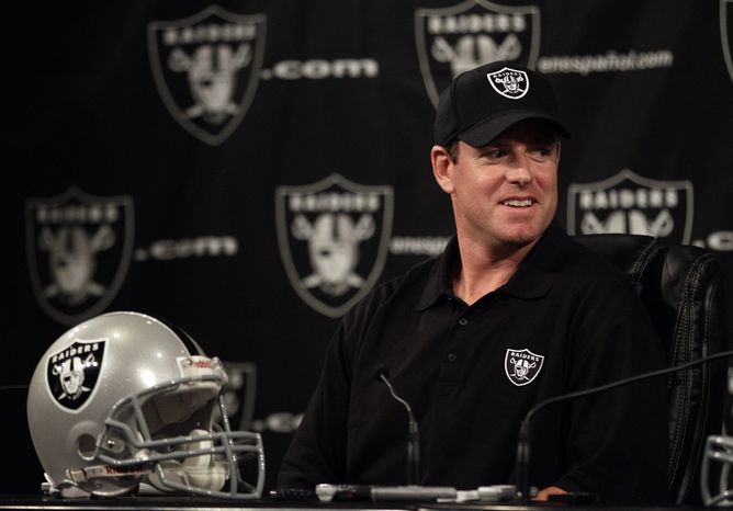 Quarterback Carson Palmer is introduced after signing with the Oakland Raiders on Tuesday, after starter Jason Campbell broke his colla