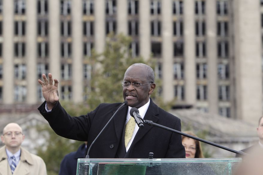 Republican presidential candidate Herman Cain addresses the crowd in front of the vacant Michigan Central Station during a campaign stop in Detroit on Oct. 21, 2011. (Associated Press)