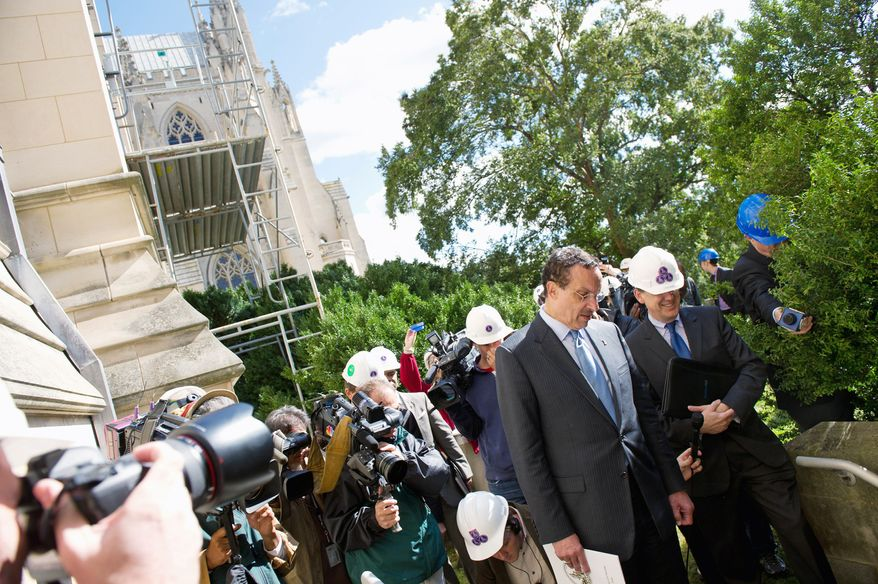D.C. Mayor Vincent Gray Oct. 20, 2011, surveys damage to the Washington National Cathedral from the Aug. 23 earthquake (Andrew Harnik / The Washington Times)