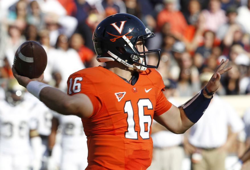 Virginia sophomore quarterback Michael Rocco has thrown for 1,150 yards on the year, but has eight interceptions and passed for only three touchdowns. (AP Photo/Steve Helber)