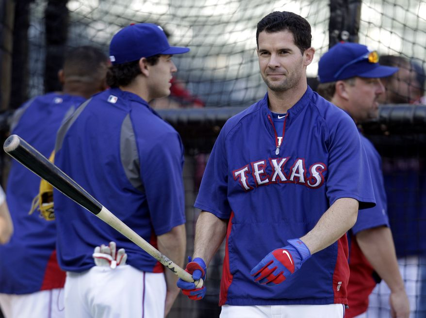 Texas Rangers' Michael Young takes batting practice Friday, Oct. 21, 2011, in Arlington, Texas. The Rangers are will play the St. Louis Cardinals in Game 3 of the World Series on Saturday. (AP Photo/Tony Gutierrez)