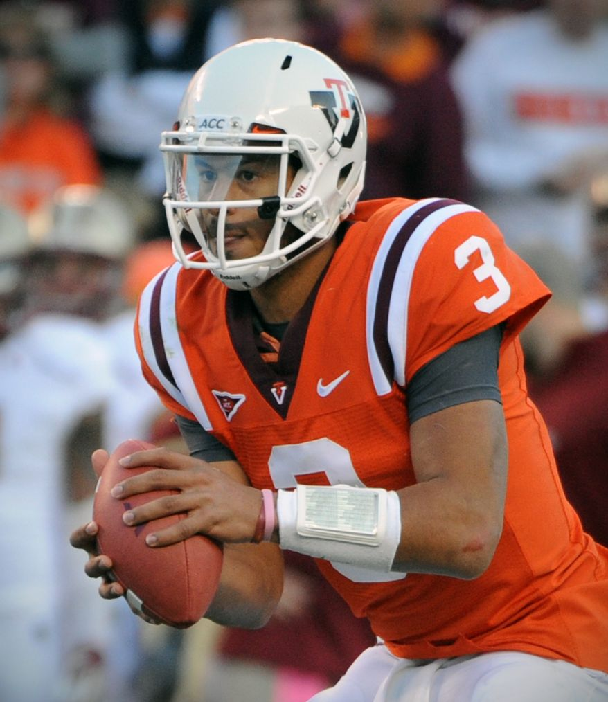 Virginia Tech quarterback Logan Thomas threw for one touchdown and ran for another in Tech's 30-14 win over Boston College.  (AP Photo/Don Petersen)