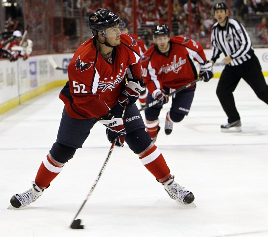 Washington Capitals defenseman Mike Green had two goals and two assists in the Caps' 7-1 win over the Detroit Red Wings on Saturday. He also was a plus-2 on the night. (Associated Press)