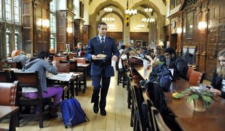 "Andrew Hendricks, the only Air Force cadet at Yale University, may get strange looks but no trouble as he grabs breakfast while wearing his Reserve Officers' Training Corps uniform. ""I think it's mainly that people are really curious because they don't see a lot of military influence on campus,"" said the sophomore from Fairfax Station, Va. (Associated Press)"