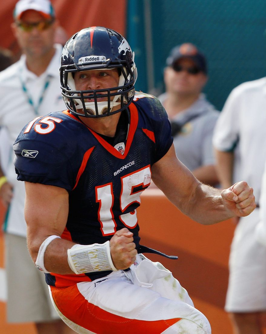 Broncos quarterback Tim Tebow celebrates a 2-point conversion that tied the game late in the fourth quarter Sunday against the Dolphins in Miami. (Associated Press)