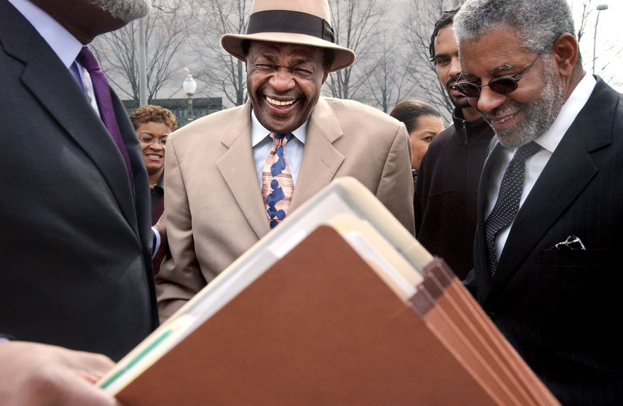 David W. Wilmot (right), a power broker in the District since Marion Barry was first elected mayor, lobbies for Wal-Mart and has ties to city-owned land where a store is to be built. (The Washington Times)