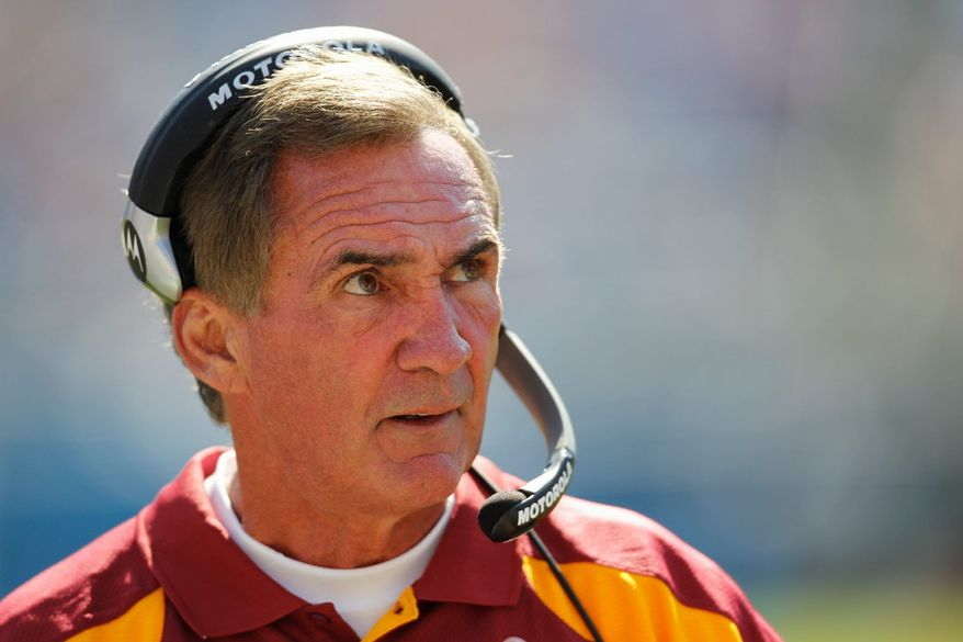 Head coach Mike Shanahan was protective of quarterback John Beck in the first half with his play called. After halftime, he opened up the offense a bit. (Associated Press)