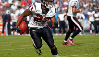 Houston Texans running back Arian Foster (23) runs against the Tennessee Titans as quarterback Matt Schaub, right, watches in the fourth quarter of an NFL football game on Sunday, Oct. 23, 2011, in Nashville, Tenn. The Texans won 41-7. (AP Photo/Wade Payne)