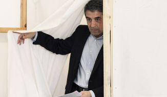 Bulgarian presidential candidate Rosen Plevneliev prepares to cast his ballot in Sofia, Bulgaria, on Sunday, Oct. 23, 2011. (AP Photo/Valentina Petrova)