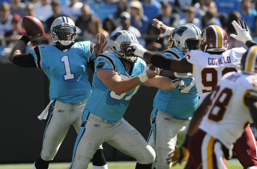 Carolina Panthers' Cam Newton (1) throws a pass against the Washington Redskins during the first quarter of an NFL football game in Charlotte, N.C., Sunday, Oct. 23, 2011. (AP Photo/Mike McCarn)