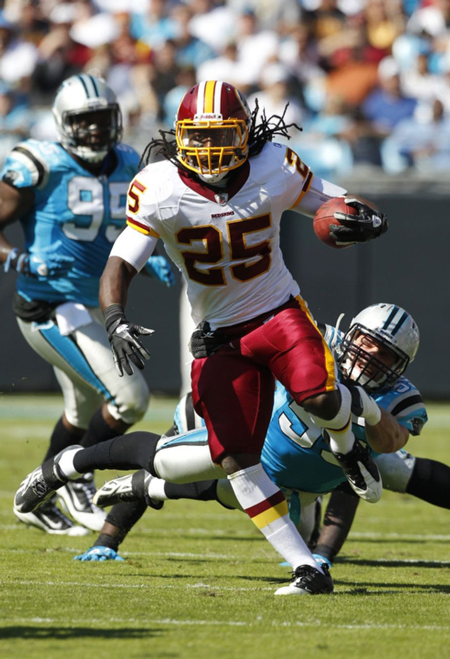 Washington Redskins' Tim Hightower (25) runs past  Dan Connor (55) during the first quarter of an NFL football game in Charlotte, N.C., Sunday, Oct. 23, 2011. (AP Photo/Bob Leverone)