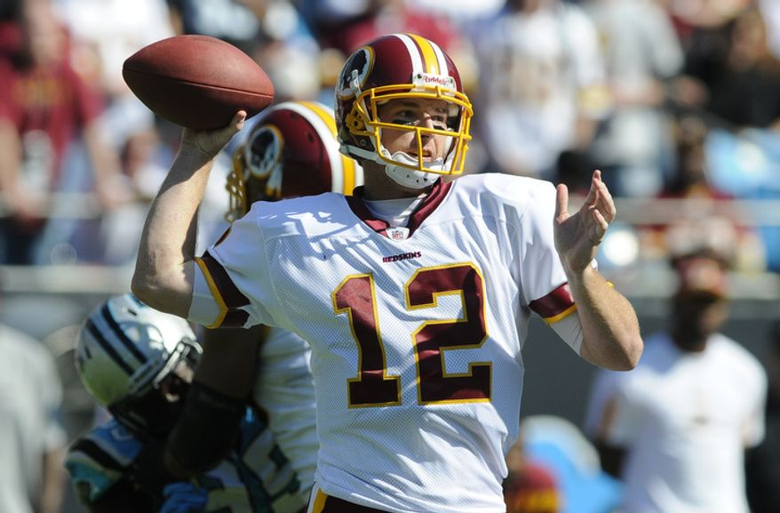 Washington Redskins' John Beck (12) throws a pass against the Carolina Panthers during the first quarter of an NFL football game in Charlotte, N.C., Sunday, Oct. 23, 2011. (AP Photo/Mike McCarn)