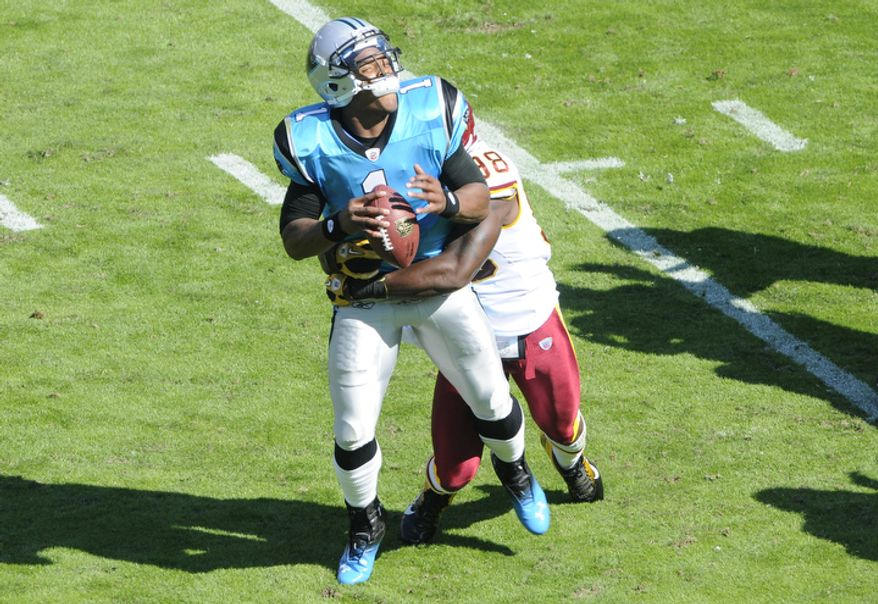 Carolina Panthers' Cam Newton (1) is sacked by Washington Redskins' Brian Orakpo (98) during the second quarter of an NFL football game in Charlotte, N.C., Sunday, Oct. 23, 2011. (AP Photo/Mike McCarn)