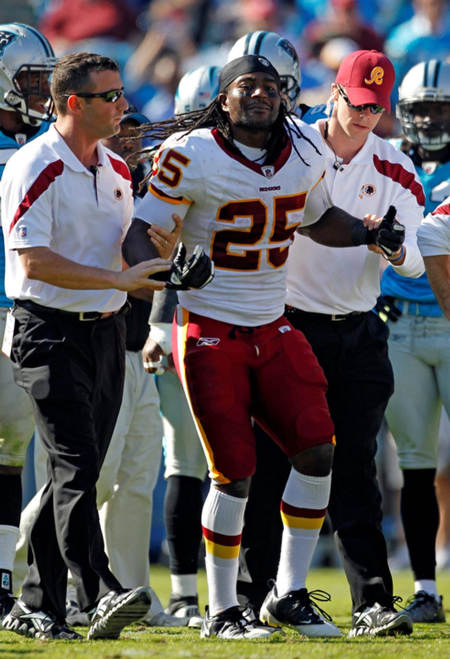 Washington Redskins' Tim Hightower (25) is helped from the field after being injured during the third quarter of against the Carolina Panthers in Charlotte, N.C., Sunday, Oct. 23, 2011. Hightower ended up tearing his ACL. (AP Photo/Bob Leverone)
