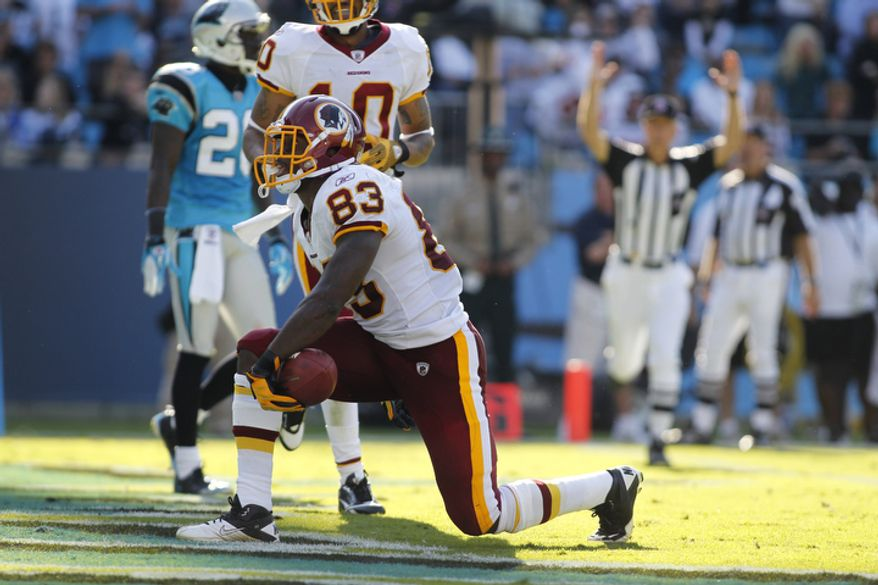 Washington Redskins' Fred Davis (83) kneels in the end zone after a touchdown catch against the Carolina Panthers during the fourth quarter of the Panthers' 33-20 win in an NFL football game in Charlotte, N.C., Sunday, Oct. 23, 2011. (AP Photo/Bob Leverone)