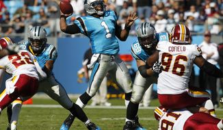 Carolina Panthers QB Cam Newton was the main reason why the Washington Redskins went home losers Sunday afternoon. (AP Photo/Chuck Burton)