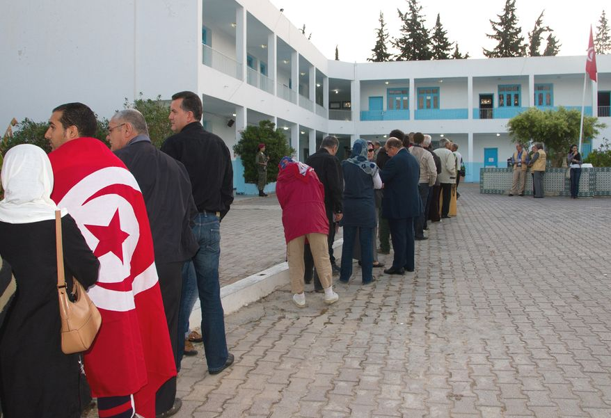 Tunisians stand in line in Menzeh, Tunisia, near the capital of Tunis, to cast their ballots in the nation's first free election on Sunday, Oct. 23, 2011. (AP Photo/Amine Landoulsi)