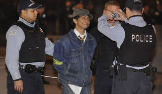 """Police arrest a protester during an """"Occupy Chicago"""" march and demonstration in Grant Park in Chicago on Sunday, Oct. 23, 2011. (AP Photo/Paul Beaty)"""