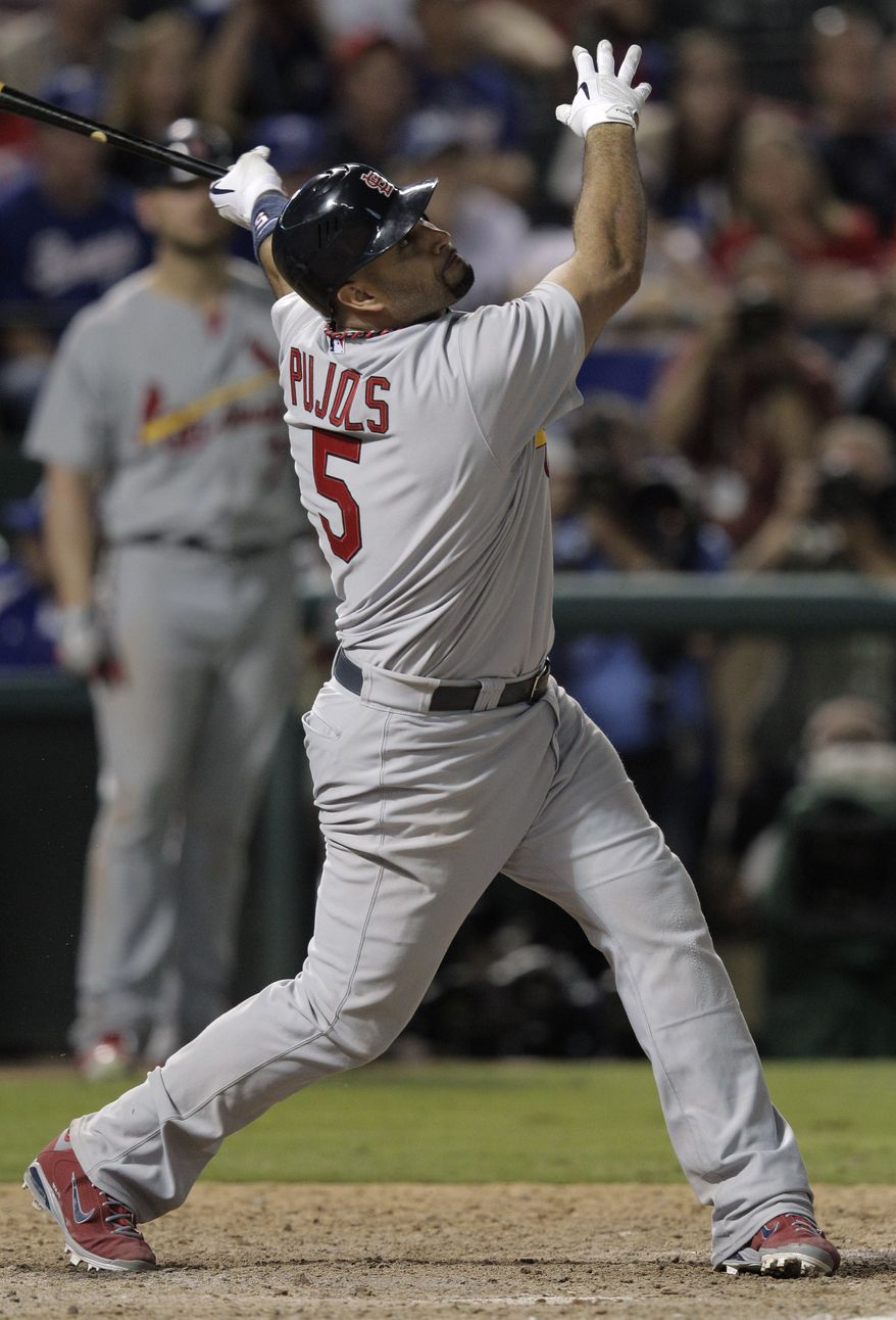 St. Louis Cardinals' Albert Pujols hit three home runs, had five hits and six RBI in Game 3 of the World Series against the Texas Rangers on Saturday. (AP Photo/Charlie Riedel)