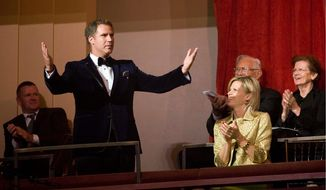 Comedian Will Ferrell embraces the applause at the Kennedy Center for the Performing Arts in Washington while accepting the Mark Twain Prize for American Humor. (Associated Press)